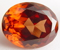 Oval Malaya garnet, orange cinnamon gemstone, exclusive Malaya garnets gemstones, garnets information